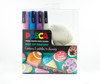Uniball 3M Posca Pen Markers. Now available in opaque, Pastell  colours, with 2 pebbles to unleash your creativity. This unique pack contains 2 pebbles to decorate as well as 4 Posca PC-3M markers (white, light blue, light pink and lavender).  A great starter kit or creative gift.  The Posca PC-3M pen has the universal bullet tip that adapts to all types of creation.  This 0.9mm - 1.3mm fine-point POSCA PC-3M pen is the quintessential creative tool used by connoisseurs.