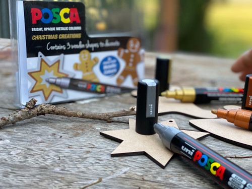 This unique pack contains 3 MDF Christmas decorations (angel, gingerbread man and a star) to decorate and use as well as 3 Posca PC-5M metallic markers (Gold, Silver and Bronze).  A great starter kit or creative gift.  The PC-5M's versatile bullet tip offers unlimited freedom of use. It adapts to all types of creation. The 1.8mm - 2.5mm medium tip of the PC-5M is the most versatile in the POSCA range.