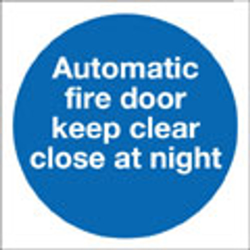 Automatic fire door keep clear close at night sign.