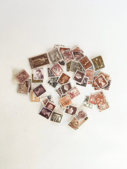 assortment of previously loved postage stamps