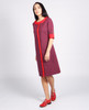 Lagom Bloomsbury Dress side view, worn by model on grey background