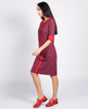 Lagom Bloomsbury Dress side/profile view, worn by model on grey background