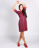 Lagom Bloomsbury Dress movement view, worn by model on grey background