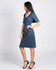 Lagom Holmes Dress Blue side view, worn by model on grey background