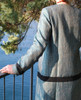 Lagom Imperia Coat lifestyle back view, worn by model on multi-coloured/realistic background