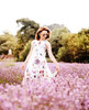 Lagom  Lavinia Dress Floral front lifestyle view on model on flowery background
