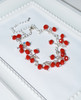 Lagom Cherry Bracelet Red side view on white scalloped background