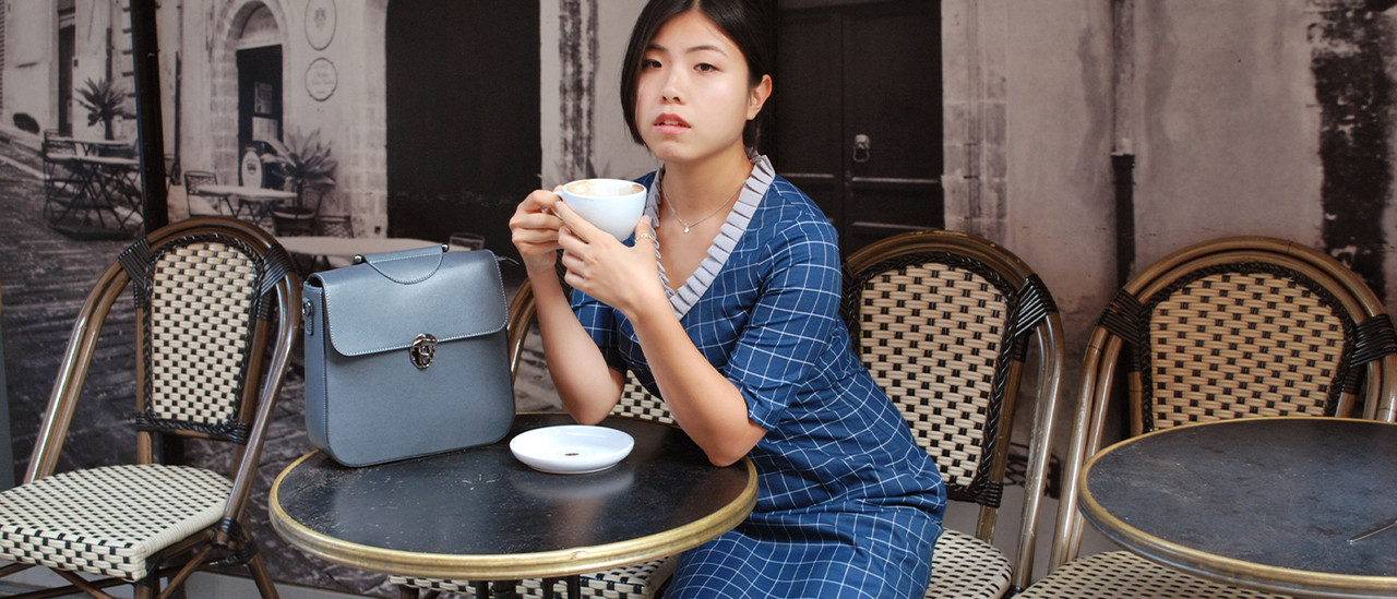 lagom autumn girl in blue dress drinking coffee