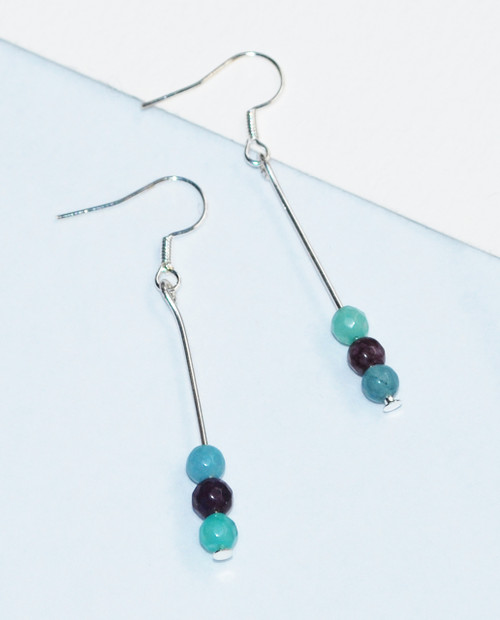 Lagom Agate Bar Earrings front view on split paper background