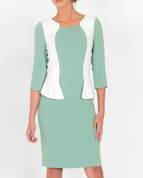 Lagom Andalucia Dress Mint front view, worn by model on grey background