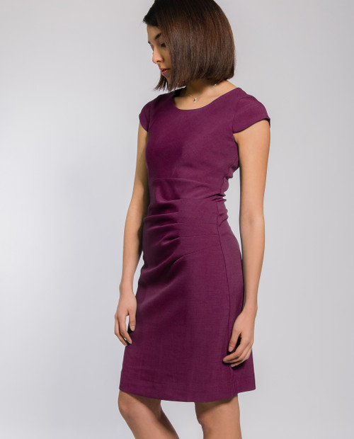 Lagom Bella Dress Aubergine side view, worn by model on grey background