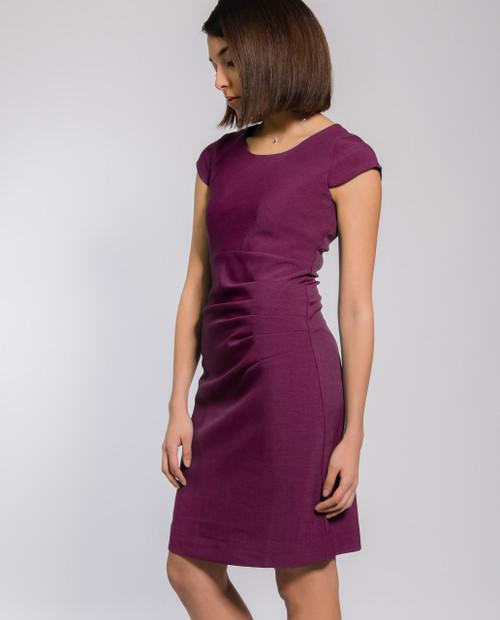 Lagom Bella Dress Aubergine side view, worn by model on grey background