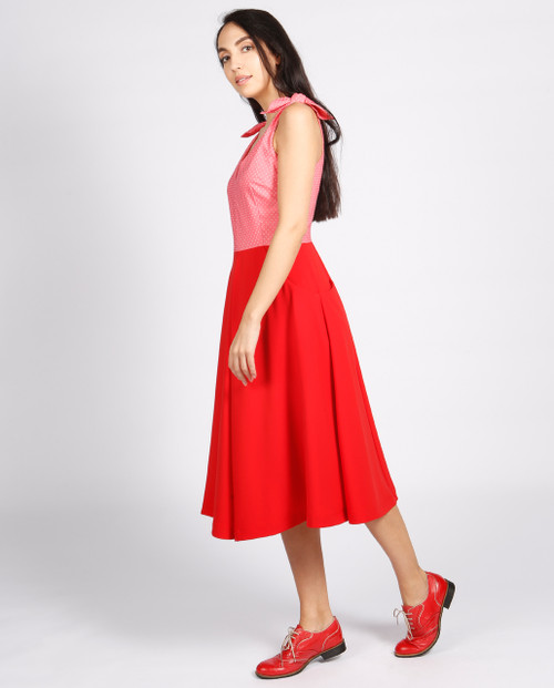 Lagom Bonbon Dress Red-Pink side view, worn by walking model on grey background