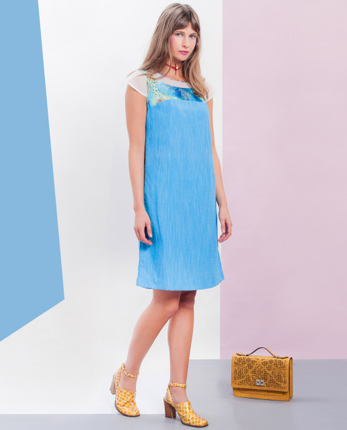 Lagom Capetown Dress Blue side view, worn by model on multi-coloured background