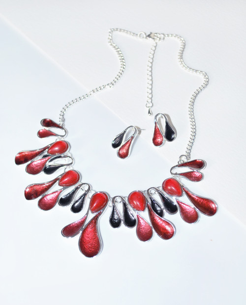 Lagom Dew Drop Necklace and Earrings Set front view on split paper background