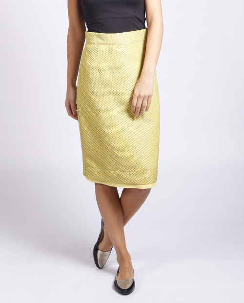 Lagom Dorset Skirt Yellow detailed view, worn by model on grey background