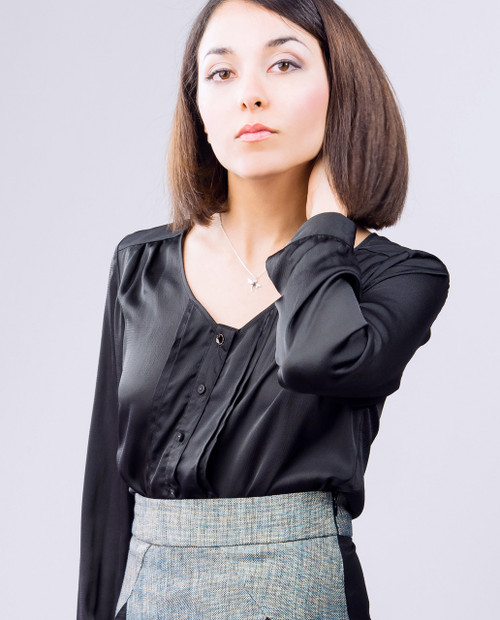 Lagom Emilia Blouse Black front view, worn by model on grey background