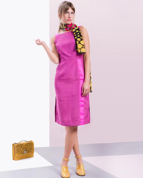 Lagom Greta Dress Fuchsia front lifestyle view, worn by model on multi-coloured background