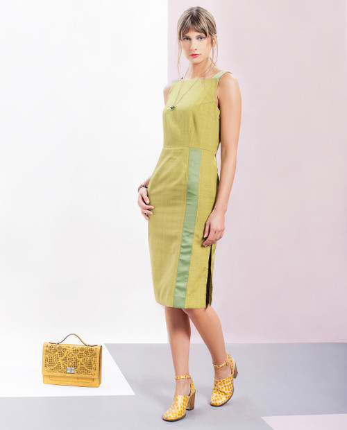 Lagom Greta Dress Green front lifestyle view, worn by model on multi-coloured background
