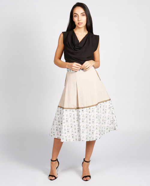 Lagom Hampstead Skirt Beige front view, worn by model on grey background