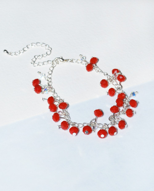 Lagom Cherry Bracelet Red side view on split paper background