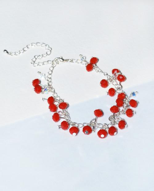 Lagom Cherry Bracelet Red side view on split paper background