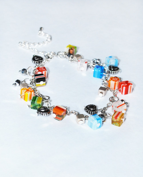 Lagom Fiori Glass Bead Charm Bracelet side view on grey background