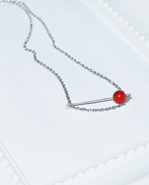 Lagom Game Bead Necklace Red side view on white dotted background