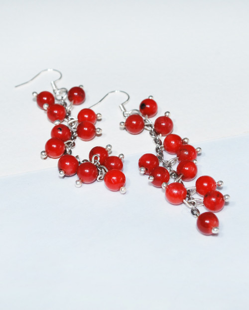 Lagom Lingolnberry Earrings Red side view on split background