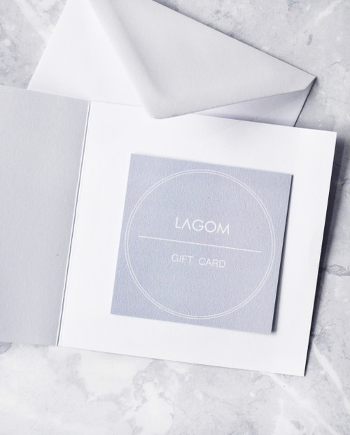 Lagom gift card with envelope on marble background