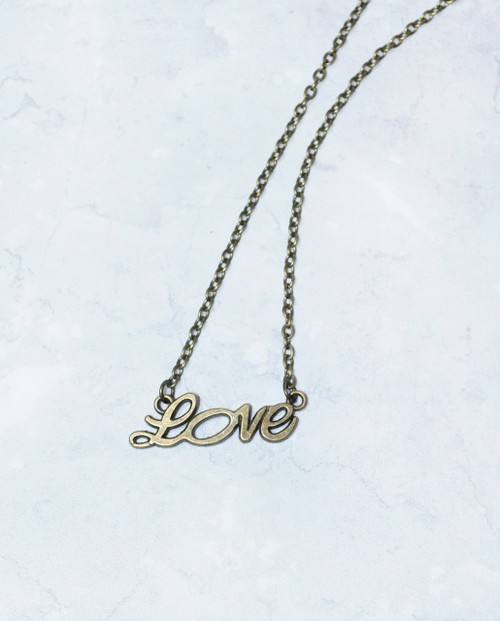 Lagom Love Necklace Bronze detailed front view on marble background