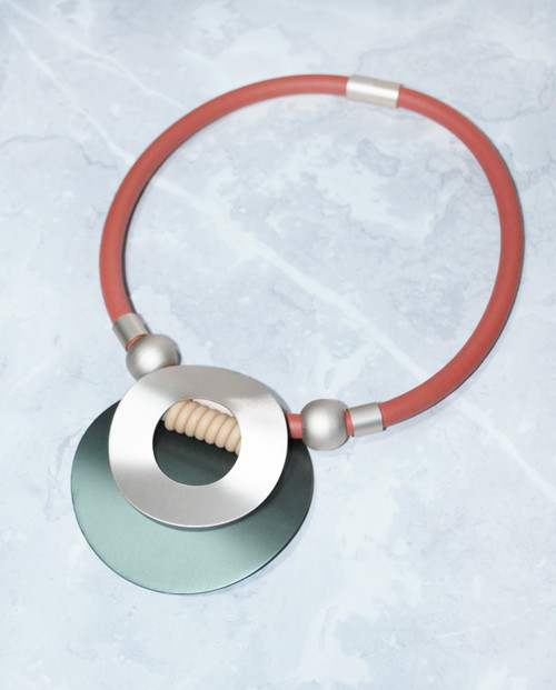 Stockholm Recycled Materials Necklace red-green flat view, £30, recycled aluminium and rubber - LAGOM