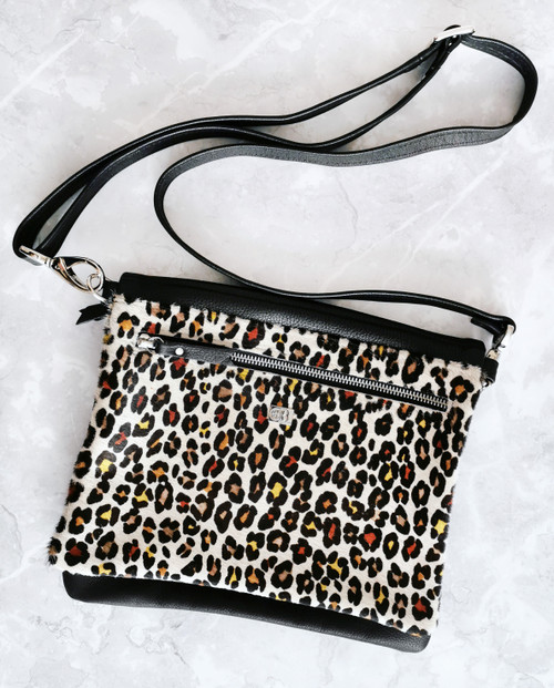 Animal print sustainable cowhide leather bag with crossbody strap