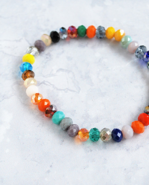 Lagom stretchy bead bracelet in rainbow colours