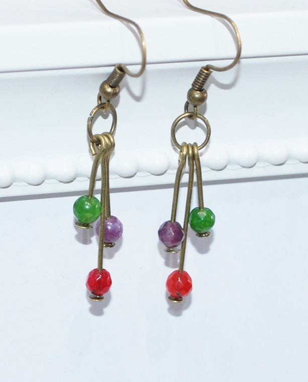Lagom Agate Cluster Earrings detailed view on white scalloped background