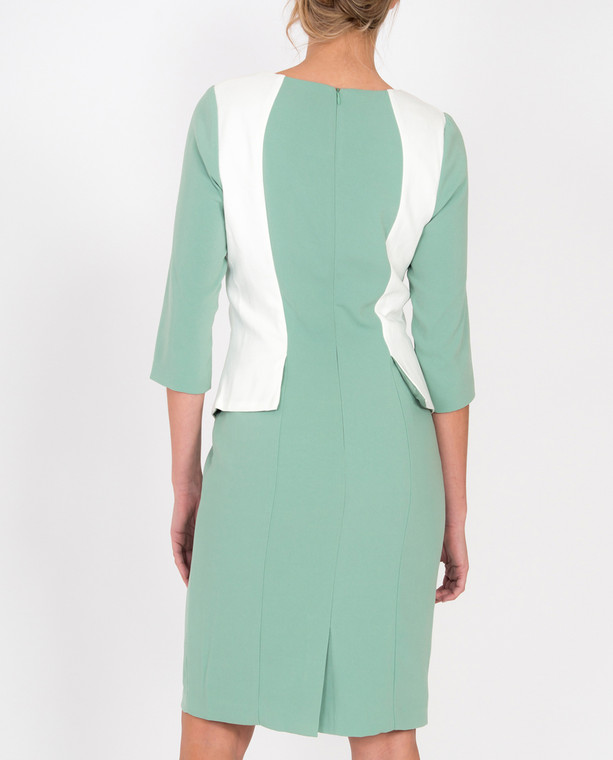 Lagom Andalucia Dress Mint back view, worn by model on grey background
