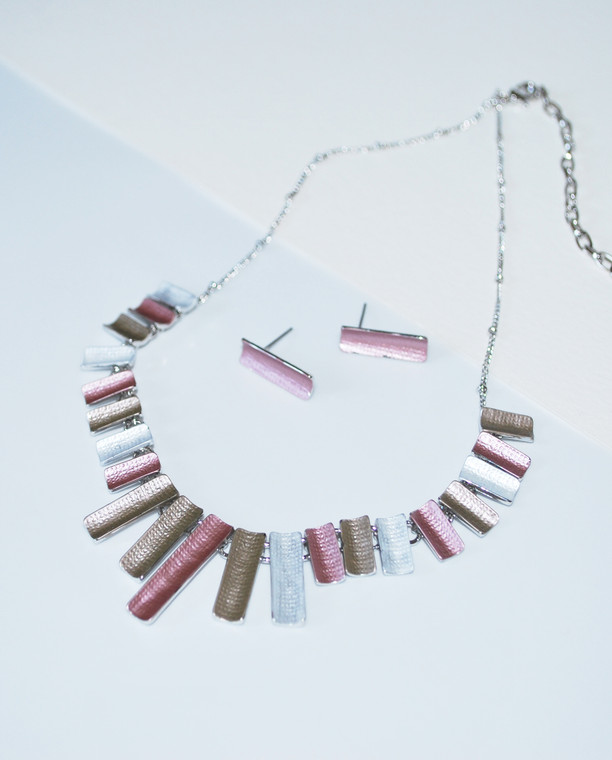 Lagom Bunting Necklace and Earrings Set front view on split paper background