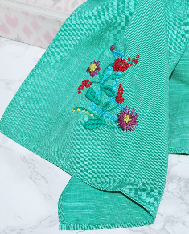 Lagom Capetown Scarf Mint Green With Embroidery detailed view on marble and paper background