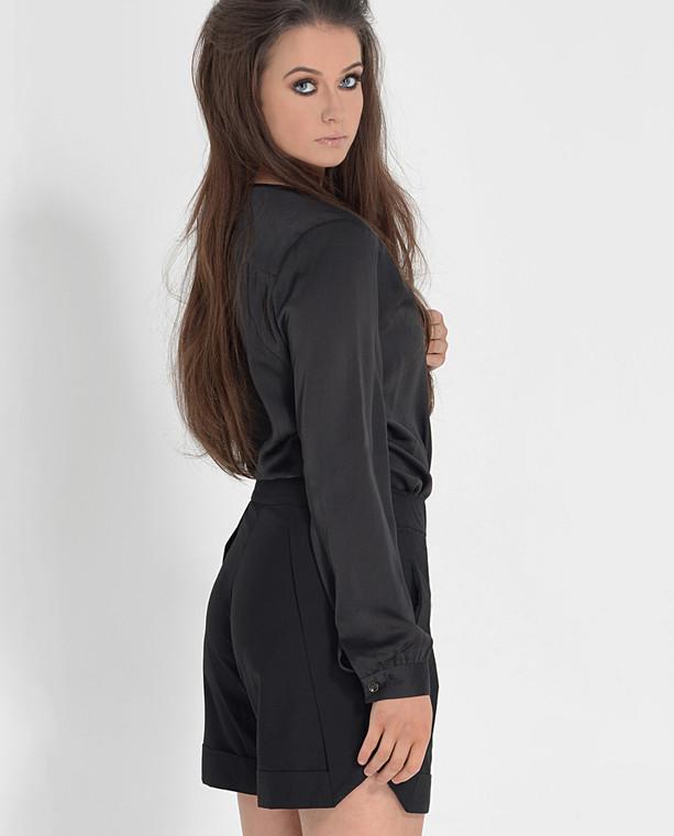 Lagom Emilia Blouse Black back view, worn tunic-style by model on grey background