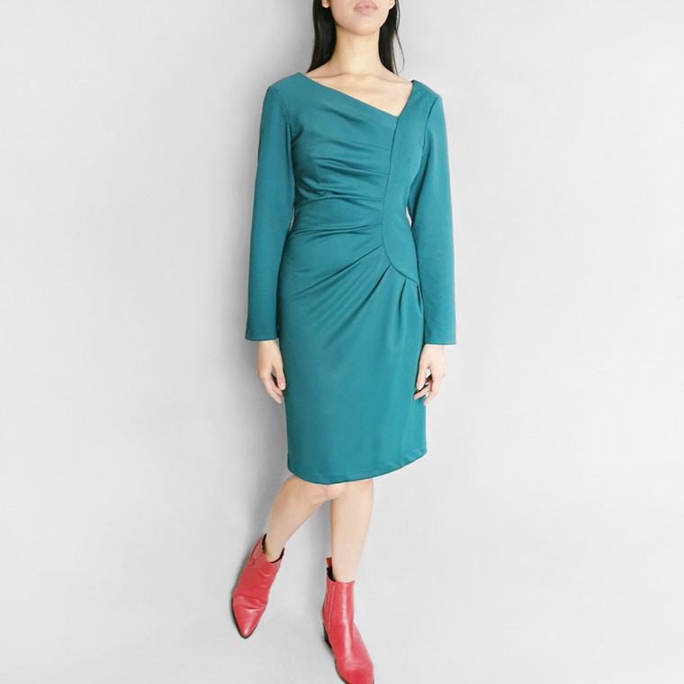 Lagom Frieda Dress Green - fitted jersey dress in bodycon pencil shape with pleats and asymmetric V neck, front view on model