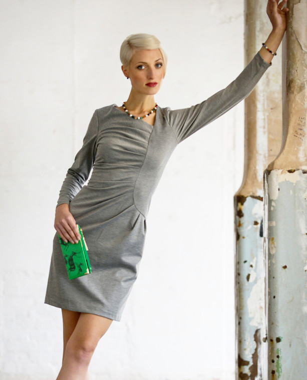 Lagom Frieda Dress Grey lifestyle view, worn by model on grey/multi-coloured background