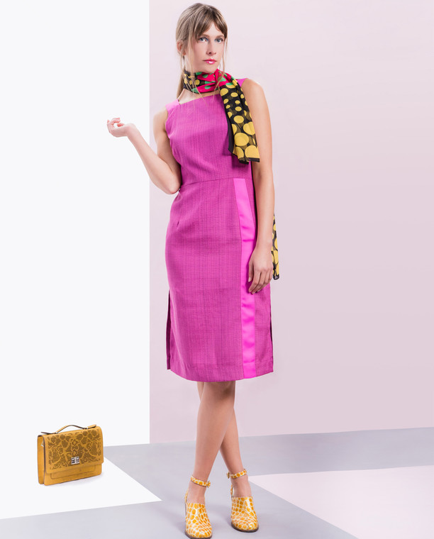 Lagom Greta Dress Fuchsia front lifestyle view, worn by model on multi-coloured background