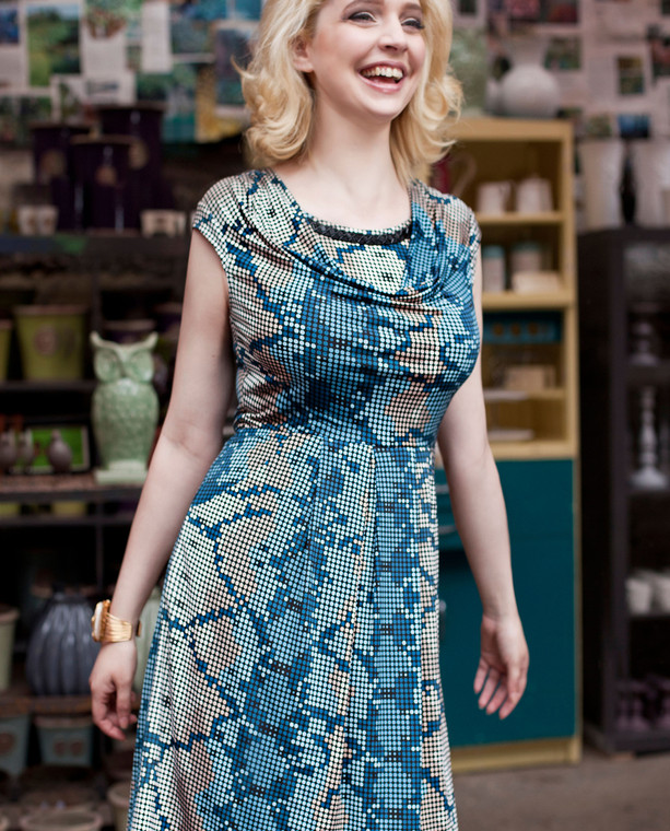 Lagom Matilda Dress Blue front lifestyle view on model on mutli-coloured background