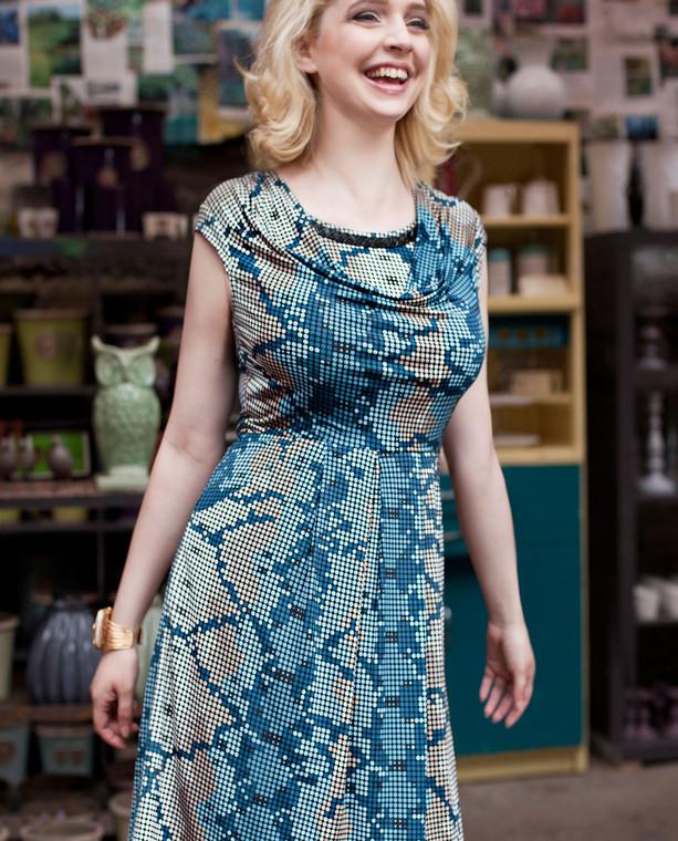 Lagom Matilda Dress Blue front lifestyle view on model on mutli-coloured background