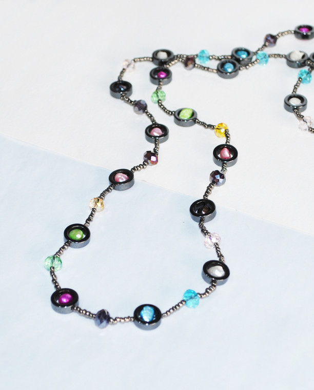 Lagom Helena Hematite Crystal Necklace front view on split background