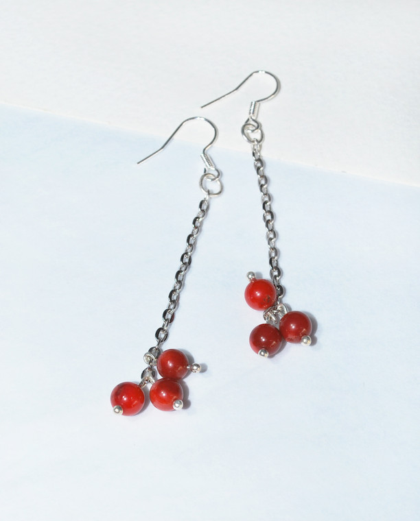 Lagom Cranberry Earrings Red front view on split paper background