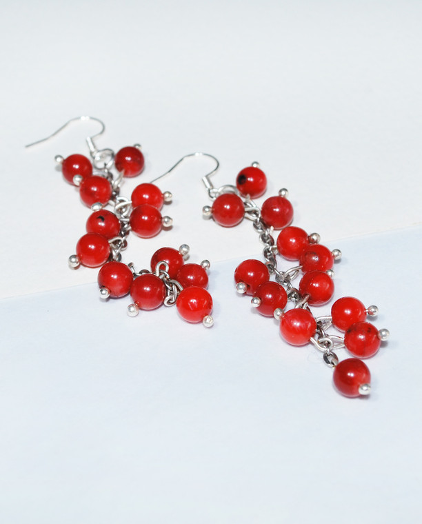 Lagom Lingolnberry Earrings Red side view on split background