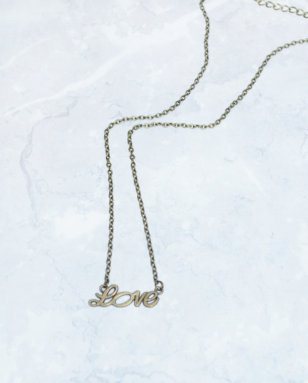 Lagom Love Necklace Bronze front view on marble background