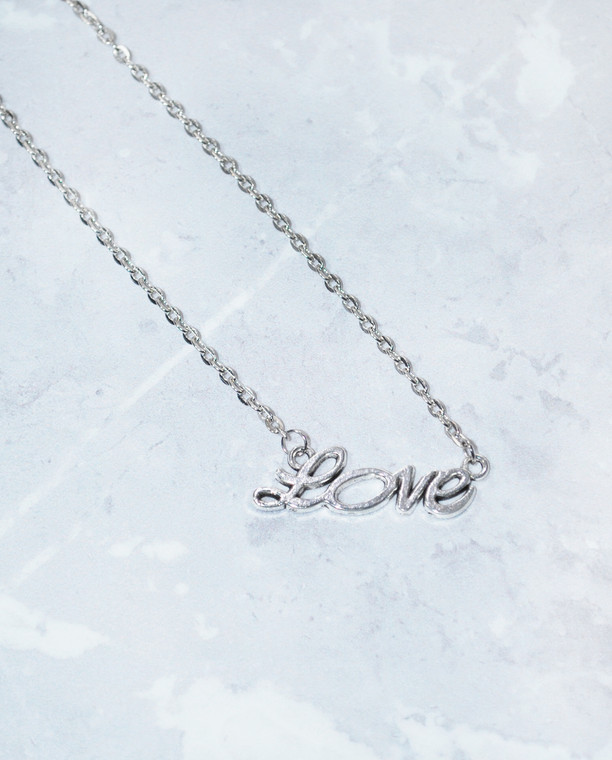 Lagom Love Necklace Silver detailed front view on marble background