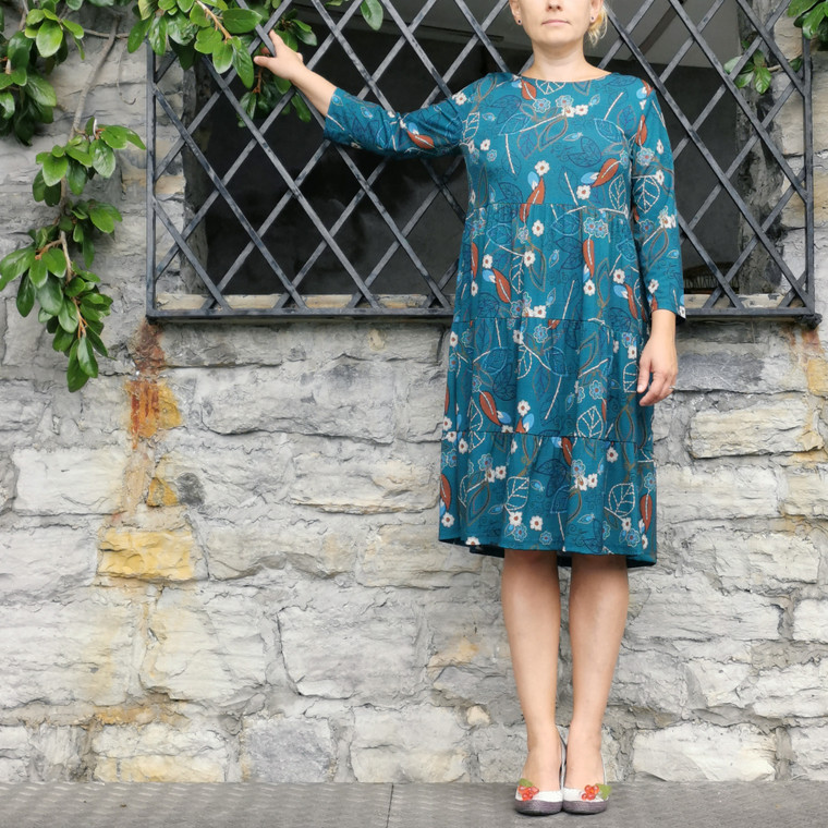 Sydney Tiered Jersey Tunic Dress in Teal Coloured Leaf Print on Model